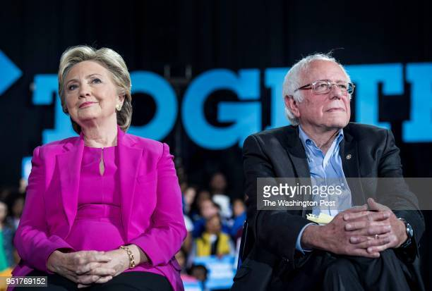 RALEIGH NC Democratic Nominee for President of the United States former Secretary of State Hillary Clinton with Senator Bernie Sanders speaks to and...