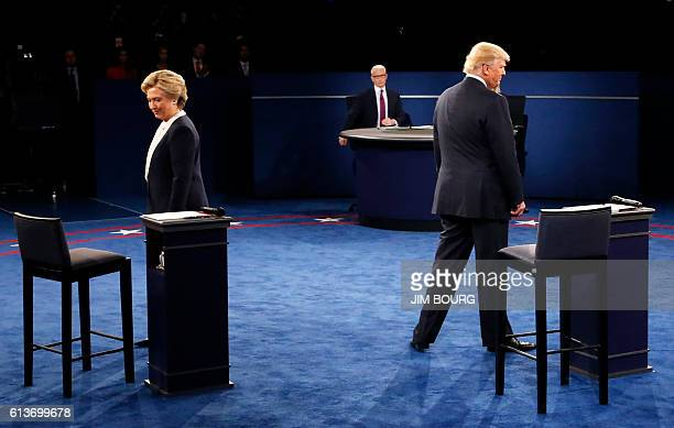 Democratic nominee Hillary Clinton and Republican nominee Donald Trump arrive on stage during the second presidential debate at Washington University...