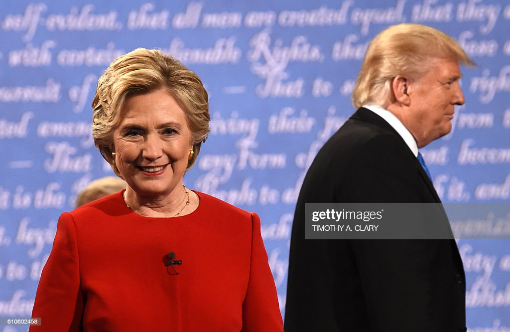 TOPSHOT - Democratic nominee Hillary Clinton (L) and Republican nominee Donald Trump leave the stage after the first presidential debate at Hofstra University in Hempstead, New York on September 26, 2016. / AFP / Timothy A. CLARY