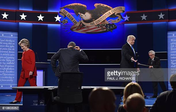 Democratic nominee Hillary Clinton and Republican nominee Donald Trump leave the stage following the first presidential debate hosted by NBC...