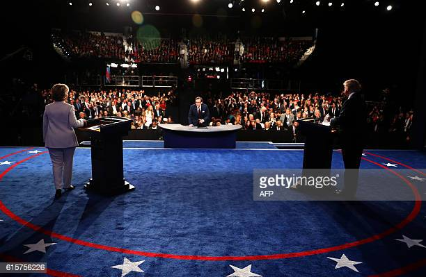 Democratic nominee Hillary Clinton and Republican nominee Donald Trump salute the audience at the end of the final presidential debate at the Thomas...