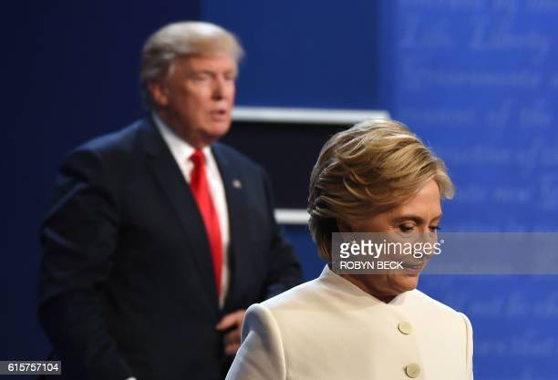 TOPSHOT Democratic nominee Hillary Clinton and Republican nominee Donald Trump walk off the stage after the final presidential debate at the Thomas...