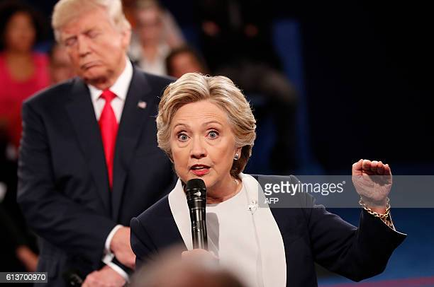 TOPSHOT Democratic nominee Hillary Clinton and Republican Presidential nominee Donald Trump participate in a town hall debate at Washington...