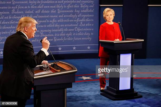 Democratic nominee Hillary Clinton exchanges with Republican nominee Donald Trump during the first presidential debate at Hofstra University in...