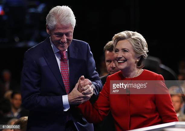 Democratic nominee Hillary Clinton is greeted by her husband Bill Clinton at the end of the first presidential debate at Hofstra University in...