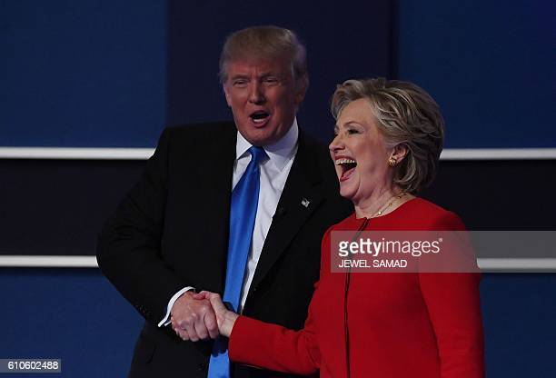 Democratic nominee Hillary Clinton shakes hands with Republican nominee Donald Trump after the first presidential debate at Hofstra University in...
