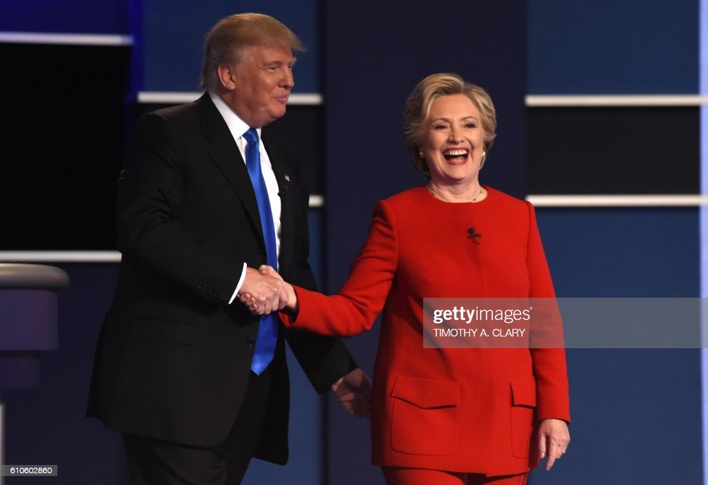 TOPSHOT - Democratic nominee Hillary Clinton (R) shakes hands with Republican nominee Donald Trump after the first presidential debate at Hofstra University in Hempstead, New York on September 26, 2016. / AFP / Timothy A. CLARY