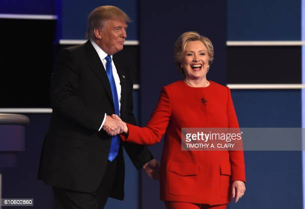 TOPSHOT Democratic nominee Hillary Clinton shakes hands with Republican nominee Donald Trump after the first presidential debate at Hofstra...