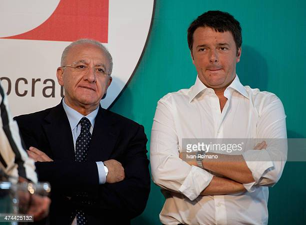 Democratic Party candidate Vincenzo De Luca stands with Italian Prime Minister Matteo Renzi during a party conference at the hotel Mediterranean for...