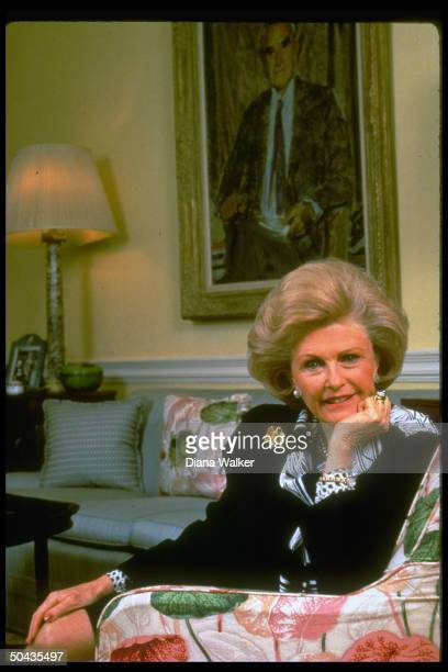 Democratic Party fundraiser French Ambdesignate Pamela Harriman at home sitting in front of wall portrait of her late husband Averell Harriman