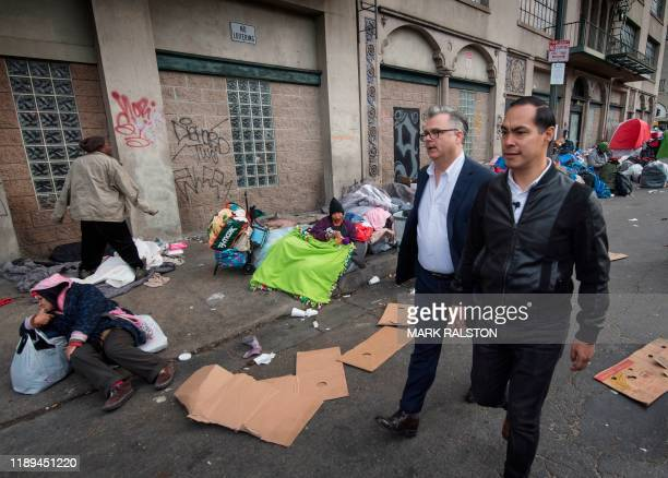 Democratic party hopeful Julian Castro tours the Skid Row area during a fact finding visit in downtown Los Angeles California on December 18 2019...