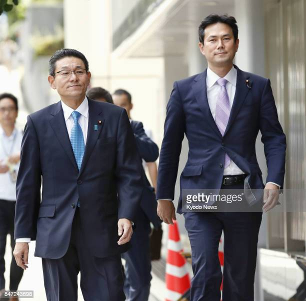 Democratic Party lawmakers Hirofumi Ryu and Yuichi Goto walk toward the main opposition party's headquarters in Tokyo on Sept 15 2017 They submitted...