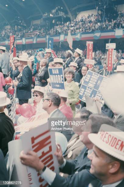 Democratic Party members holding placards in support of Dan Moore, a nominee for the Democratic Party's 1968 presidential candidate, at the 1968...