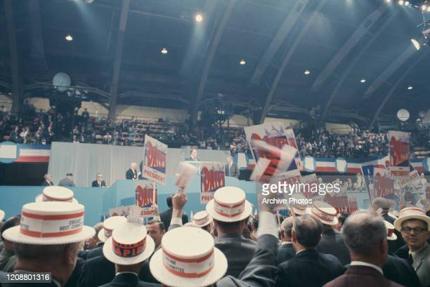 Democratic Party members holding placards in support of Mayor of Chicago Richard J Daley at the 1968 Democratic National Convention, held at the...
