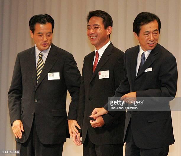 Democratic Party of Japan Former president Katsuya Okada newly elected president Seiji Maehara and Naoto Kan shake hands after the presidential...