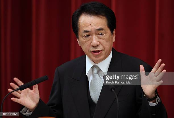 Democratic Party of Japan leader Naoto Kan voted in as Japan's new prime minister speaks during a press conference at his official residence on June...