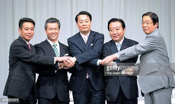 Democratic Party of Japan presidential election candidates Seiji Maehara Sumio Mabuchi Banri Kaieda Yoshihiko Noda and Michihiko Kano shakes hands...