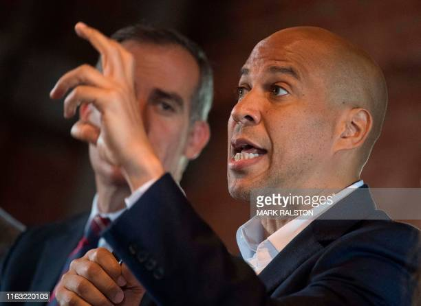 Democratic Party presidential candidate Cory Booker speaks beside Los Angeles mayor Eric Garcetti during a roundtable on gun violence prevention in...
