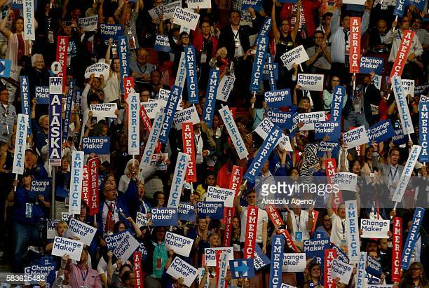 Democratic Party supporters hold banners at Wells Fargo Center during a speech of the former President Bill Clinton in support of the Democratic...