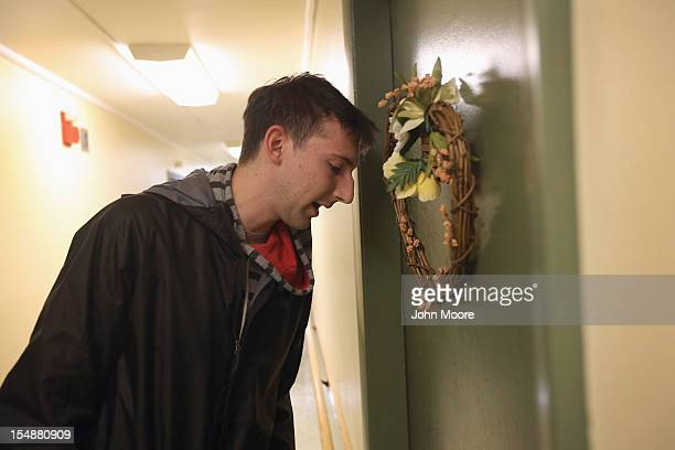 Democratic party volunteer Matt Lattanzi speaks with a potential voter while canvasing for votes in an apartment building October 28 2012 in...