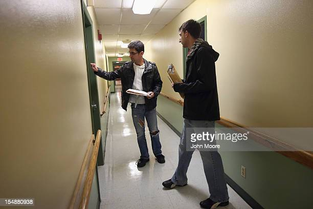 Democratic party volunteers Chris Lettero and Matt Lattanzi knock on apartment doors while canvasing for votes October 28 2012 in Youngstown Ohio The...