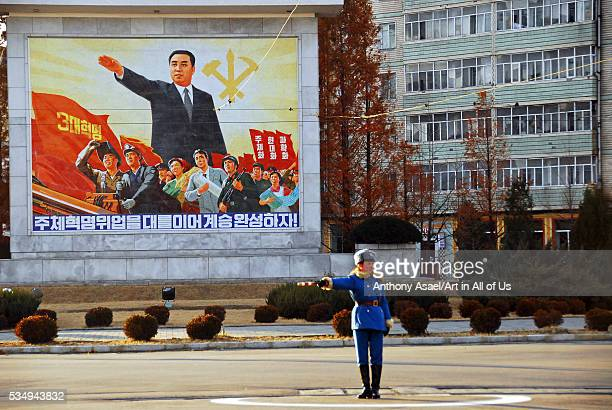 Democratic People's Republic of Korea Pyongyang capital city A woman police agent managing the traffic standing in her blue uniform in the middle of...