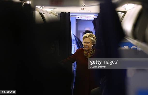 Democratic preisdential nominee former Secretary of State Hillary Clinton talks with members of her staff aboard her campaign plane at Westchester...