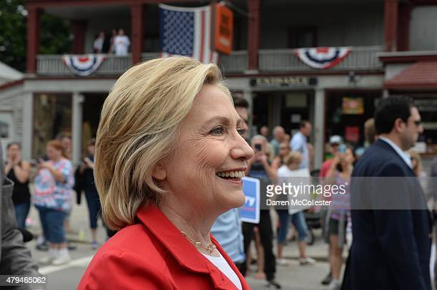 Democratic presidental candidate Hillary Clinton marches in the Gorham fourth of July parade July 4 2015 in Gorham New Hampshire Clinton is on a two...