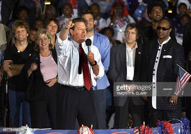 Democratic presidental candidate US Vice President Al Gore addresses a rally in South Beach in Miami on stage with musician John Bon Jovi his wife...