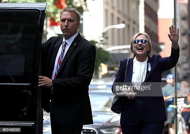 Democratic presidental nominee former Secretary of State Hillary Clinton waves as she leaves the home of her daughter Chelsea Clinton on September 11...