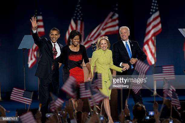 Democratic presidentelect Barack Obama and his wife Michelle left wave to supporters with Democratic vice presidentelect Joe Biden and his wife Jill...