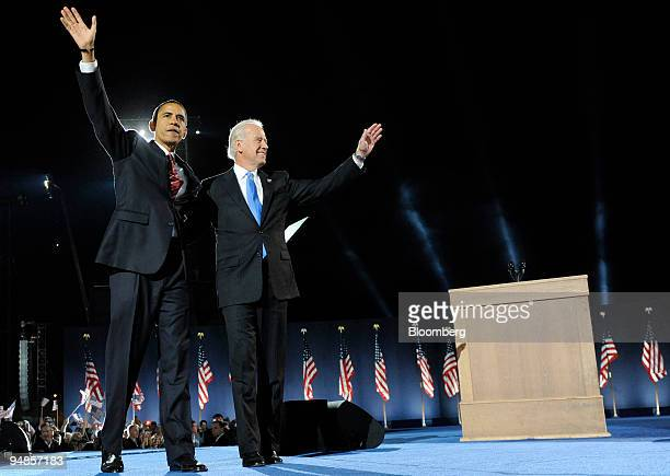 Democratic presidentelect Barack Obama left and vice presidentelect Joe Biden acknowledge the crowd after winning the US presidential elections at an...