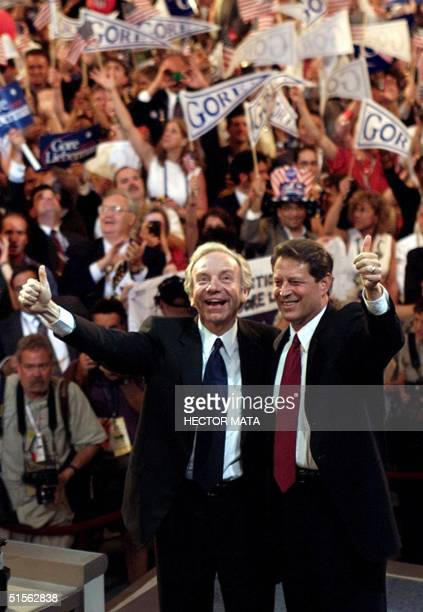 Democratic presidential candidate Al Gore and his running mate Joseph Lieberman give the thumbsup at the end of the Democratic National Convention in...