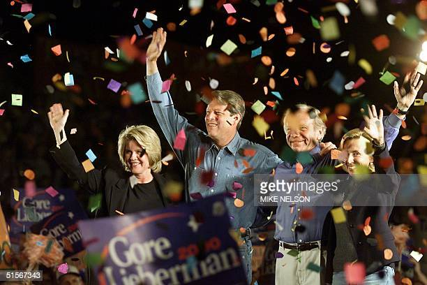 Democratic Presidential candidate Al Gore his wife Tipper his running mate Senator Joseph Lieberman and Lieberman's wife Hadassah wave to supporters...