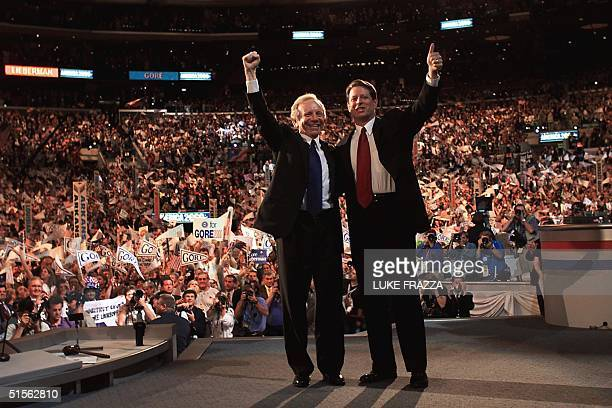 Democratic presidential candidate Al Gore is joined by vice presidential candidate Joseph Lieberman on the stage of the Democratic National...