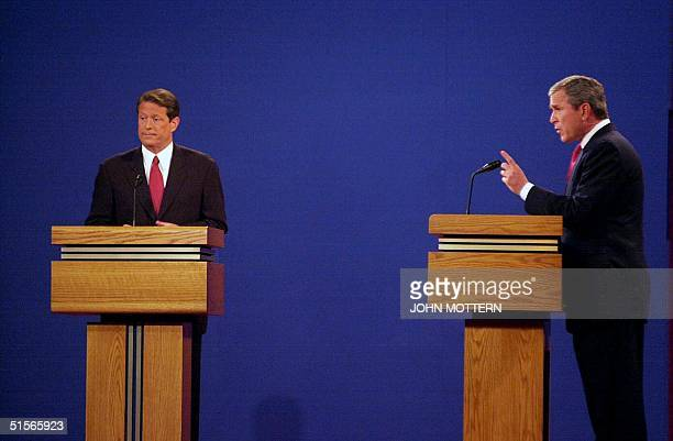 Democratic presidential candidate Al Gore listens as his Republican opponent George W Bush makes a point during their debate 03 October at the...