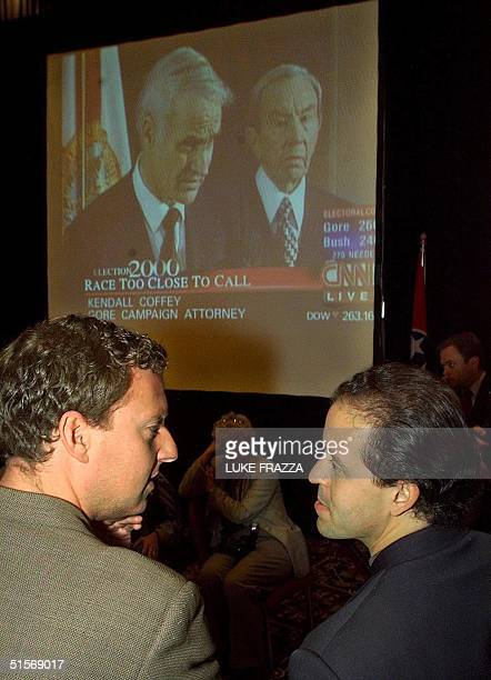 Democratic presidential candidate Al Gore's campaign spokesman Chris Lehane and traveling ChiefofStaff Michael Feldman confer at the press filing...