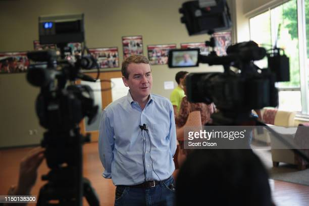 Democratic presidential candidate and Colorado Senator Michael Bennet speaks to local reporters following a campaign stop hosted by the Woodbury...