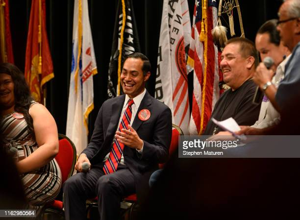 Democratic presidential candidate and former Housing and Urban Development Secretary Julian Castro laughs at a joke during the Frank LaMere Native...