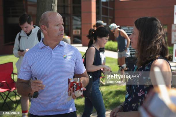 Democratic presidential candidate and former Maryland congressman John Delaney greets people while campaigning at the Capital City Pride Fest on June...