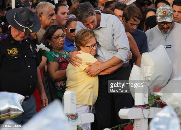 Democratic presidential candidate and former Rep. Beto O'Rourke hugs a woman at a makeshift memorial outside Walmart honoring victims of a mass...