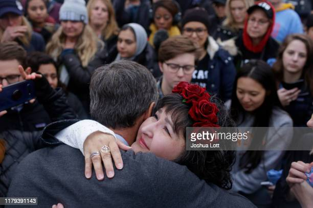 Democratic presidential candidate and former Rep. Beto O'Rourke hugs a supporter after announcing he was dropping out of the presidential race before...