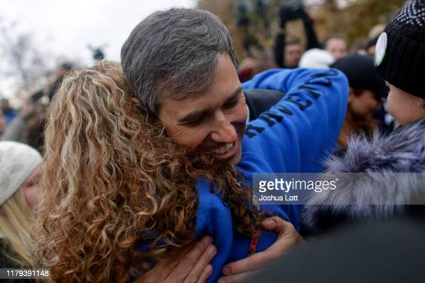 Democratic presidential candidate and former Rep Beto O'Rourke hugs a supporter after announcing he was dropping out of the presidential race before...