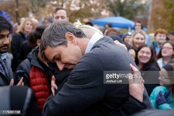 Democratic presidential candidate and former Rep Beto O'Rourke hugs volunteer Charlie Jordan after announcing he was dropping out of the presidential...