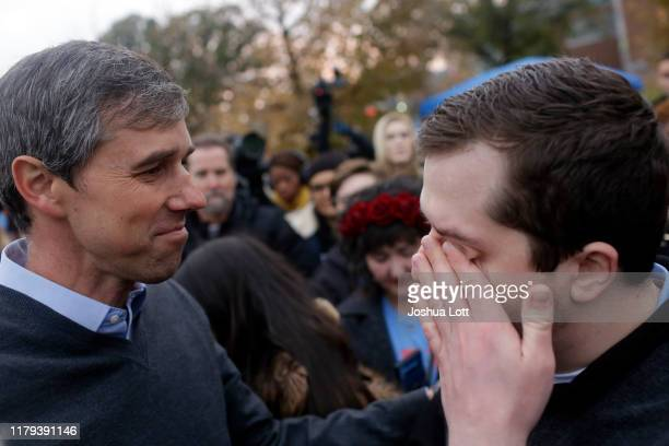Democratic presidential candidate and former Rep. Beto O'Rourke speaks to a supporter as he wipes his eye after O'Rourke announced he was dropping...