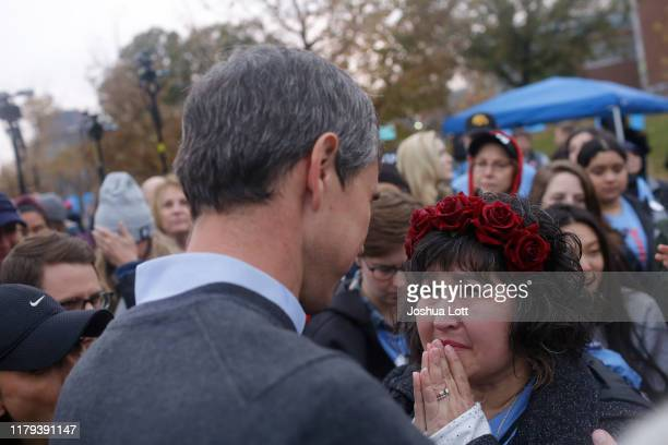 Democratic presidential candidate and former Rep Beto O'Rourke speaks to a supporter after announcing he was dropping out of the presidential race...