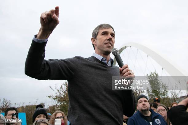 Democratic presidential candidate and former Rep Beto O'Rourke speaks to a supporter as he wipes his eye after O'Rourke announced he was dropping out...