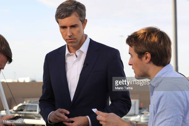 Democratic presidential candidate and former Rep. Beto O'Rourke prepares to be interviewed outside a Walmart near the scene of a mass shooting which...