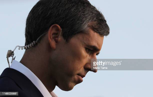 Democratic presidential candidate and former Rep Beto O'Rourke prepares to be interviewed outside a Walmart near the scene of a mass shooting which...