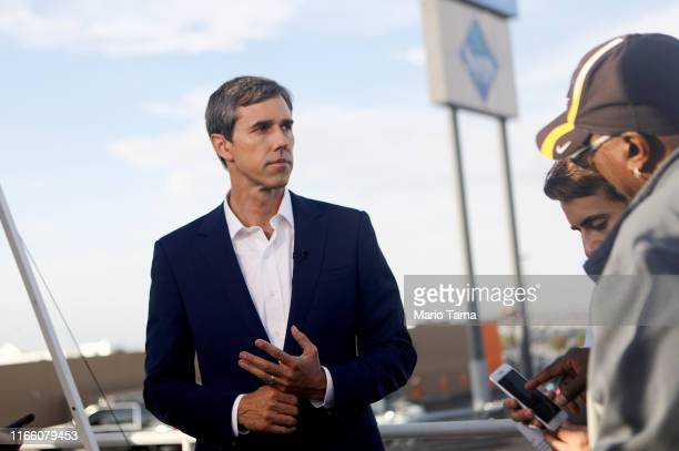 Democratic presidential candidate and former Rep Beto O'Rourke prepares to be interviewed outside Walmart near the scene of a mass shooting which...